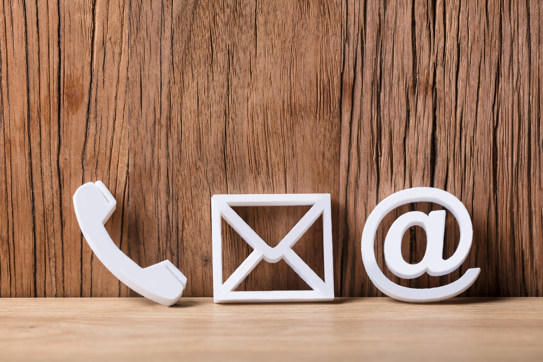 Close-up Of  Phone, Email and Post Icons